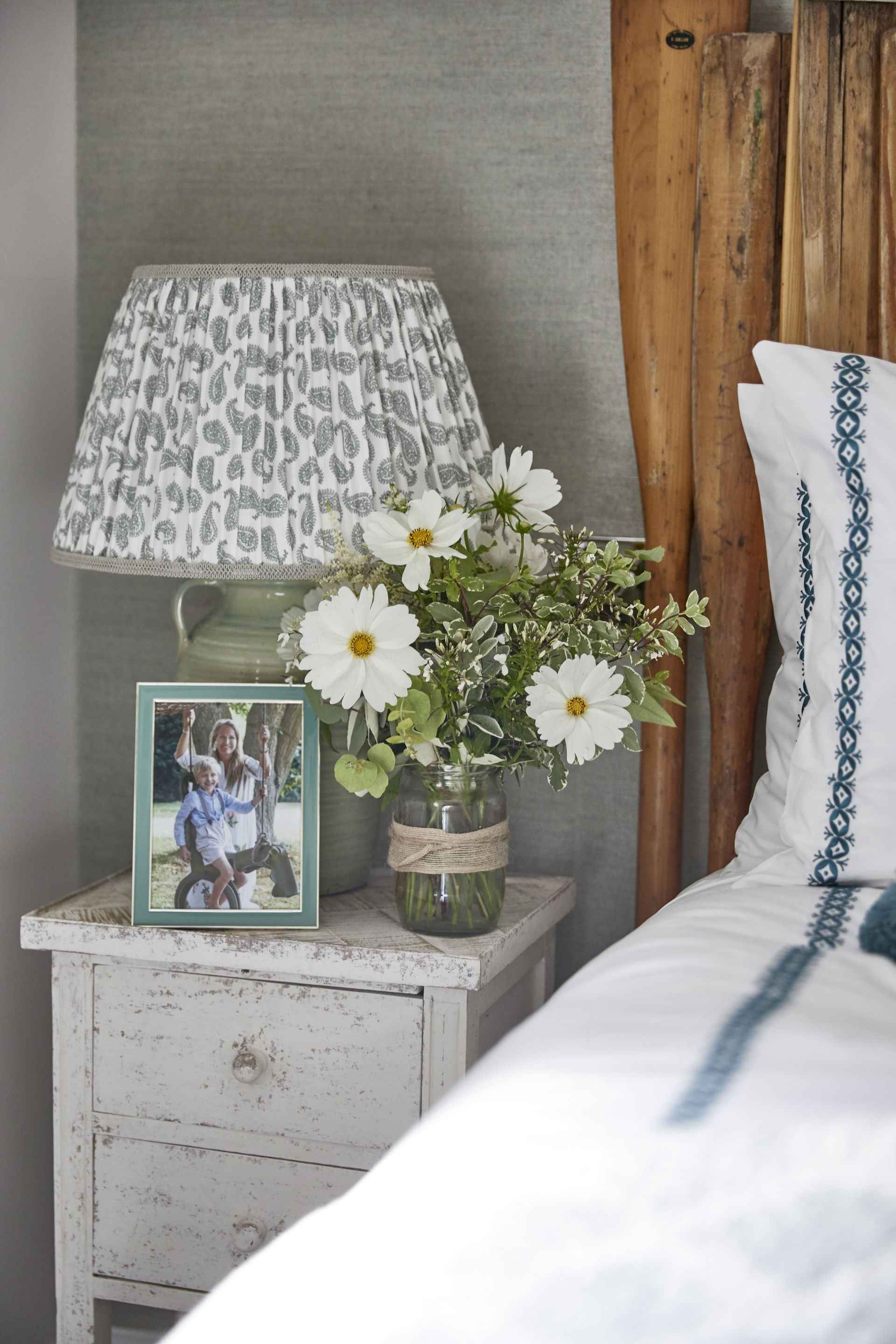 Side table with flowers at the oar room in mountain ash house